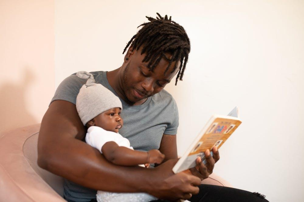 Dad reading to his baby