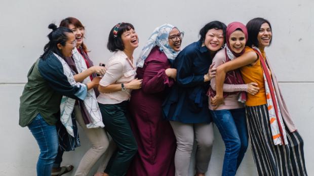 Group of teenage girls laughing