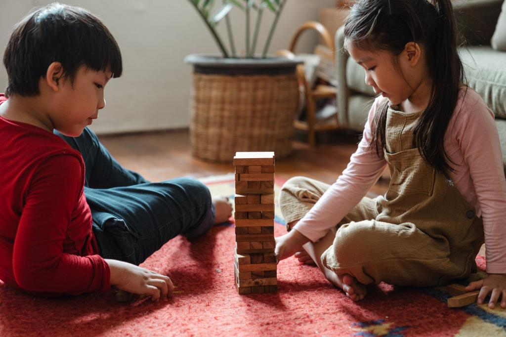 Young siblings playing Jenga together